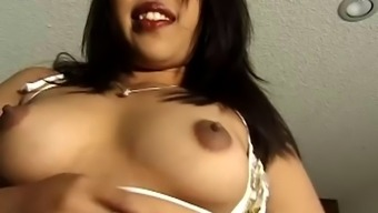 Solo Asian in sexy dark lipstick plays with her clit