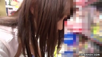 Japanese girl Mikuni Maisaki is masturbating her slit in the office