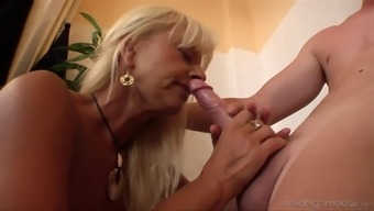 Kinky mature blonde giving a blowjob and a rimjob to a lucky dude
