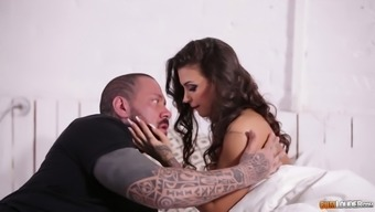Tattooed stud fucks pretty hot Italian babe Susy Gala and cums on her ass
