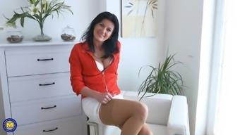 Brunette MILF in high heels Celine Noiret masturbates with toys