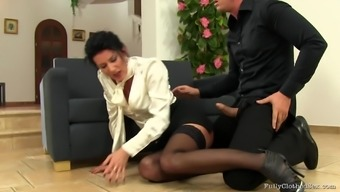 Elegantly dressed woman in stockings sucks a cock and gets fucked