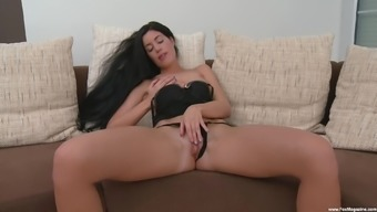 Solo brunette girl April Blue moans while she fingers herself