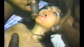 Interracial gangbang for a busty brunette in vintage clip