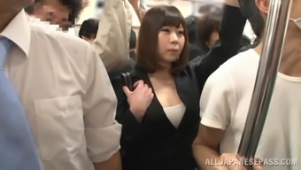 Busty Japanese milf gets her cunt toyed and fucked in a bus
