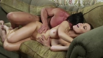 Pretty cougar with gorgeous tits enjoying a hardcore doggy style fuck on her couch