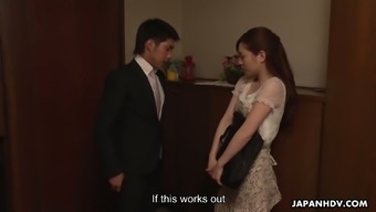 Lovely Japanese babe Emi Sasaki digs her wet hairy pussy with fingers