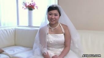 Just ordinary cute Japanese bride Emi Koizumi posing in wedding dress