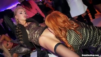 Drunk girls get bold and eat out wet pussy in a club