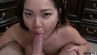 Chunky Asian girl with big boobs wearing stockings and sucking a cock