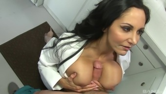 Busty brunette in nurse's uniform sucks a long pecker
