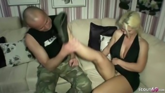 German mother and stepdaughter give footjob to let him cum