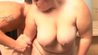 Chubby horny chick eating dick