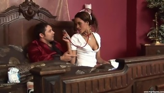 Keisha Kane wears costume for nurse and sits on a hard shaft on the bed