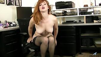 Redhead secretary Amber Dawn drops her panties to masturbate