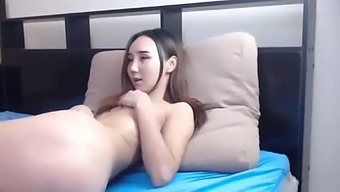 petite shy asian fingering her pussy