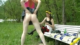 Pallid redhead with nice thighs pees right in the forest