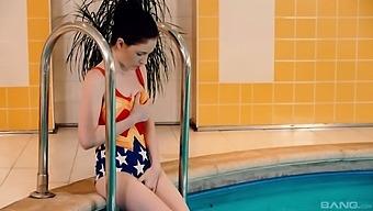 Poolside masturbation for Kiara Gold after she sheds Wonder Woman swimwear
