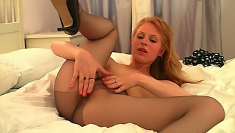 Horny wench Amber takes off her polka dot dress to show off her pantyhose