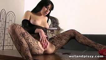 Amateur Czech chick in body fishnets masturbates pussy and pisses