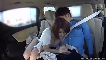 Kinky couple enjoys having fun in back of the moving car. HD