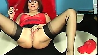 Very hot granny in lingerie and high heels masturbating